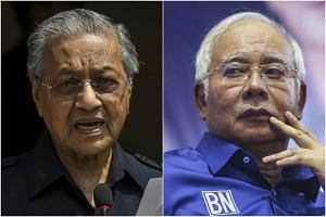 Malaysian Prime Minister Mahathir Mohamad (left) confirmed he had ordered travel restrictions on former premier Najib Razak after the latter said he would take a short break to consider his future.