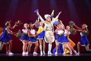 Maris McCulley (centre in white) as Elle Woods in Legally Blonde: The Musical at Sands Theatre at Marina Bay Sands.