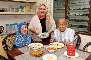 Ms Atiqah Nik Ghazali (centre) often cooks over the weekends for her husband and family. Pictured here with her is her mother Rosemlar Mohd Nasir and father Nik Muhamad Ghazali Nik Yusuf.