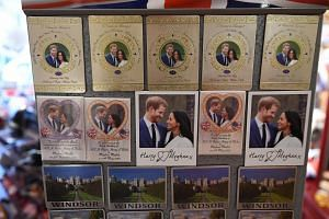 Royal wedding themed fridge magnets are displayed in a store in Windsor, on May 14, 2018.