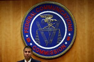 Chairman Ajit Pai speaks ahead of the vote on the repeal of so-called net neutrality rules at the Federal Communications Commission in Washington, US on Dec 14, 2017.
