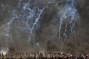 Israeli troops fire tear-gas at Palestinian protesters during clashes after protests near the border with Israel in the east of Jabaliya in the northern Gaza Strip, on May 14, 2018.