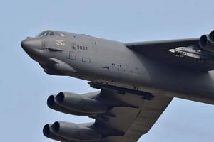 File photo showing a US B-52 aircraft flying over the Osan Air Base in Pyeongtaek, south of Seoul, in 2016.
