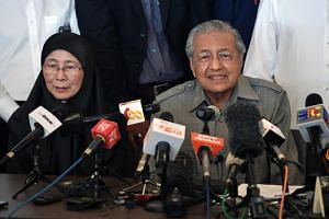 PKR president Wan Azizah Wan Ismail and Prime Minister Mahathir Mohamad attending a press conference at the Sheraton Petaling Jaya Hotel on May 10, 2018.