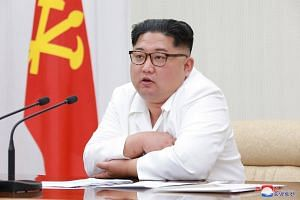 North Korean leader Kim Jong Un chairing the first Enlarged Meeting of the 7th Central Military Commission of the Workers' Party of Korea in Pyongyang, on May 18, 2018.