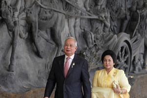 Najib Razak and his wife Rosmah Mansor arrive at the Bali Nusa Dua Convention Center before the opening ceremony of the Asean Summit in Nusa Dua, Bali on Nov 17, 2011.