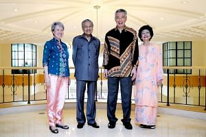 Prime Minister Lee Hsien Loong and Mrs Lee pose for a photo with Malaysian Prime Minister Mahathir Mohamad and his wife Siti Hasmah Mohd Ali at the Perdana Leadership Foundation in Putrajaya, on May 19, 2018.