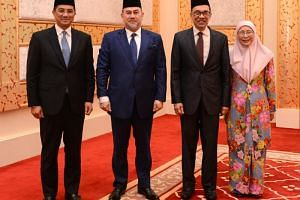 (From left) Selangor Menteri Besar Azmin Ali, Malaysia's King Muhammad V, Pakatan Harapan presidential council member Anwar Ibrahim and Mr Anwar's wife, Malaysia's Deputy Prime Minister Wan Azizah Wan Ismail pose for pictures following Mr Anwar's rel