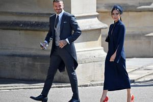 David and Victoria Beckham arrive for the wedding ceremony of Britain's Prince Harry to Meghan Markle in Windsor on May 19, 2018.