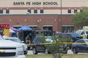Emergency crews gather in the parking lot of Santa Fe High School where at least ten people were killed on May 18, 2018 in Santa Fe, Texas.