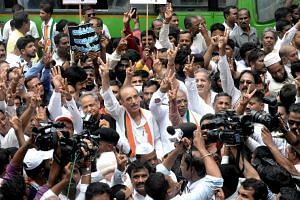 Senior Congress Party leaders and supporters shouting slogans against Karnataka governor Valubhai Vala and Indian PM Narendra Modi, in Bangalore on May 18, 2018.