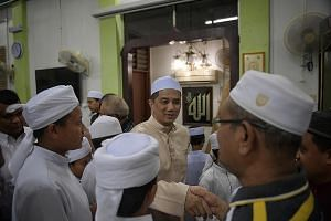Datuk Seri Azmin Ali greeting supporters in a mosque during campaigning earlier this month. The PKR deputy president is set to have an enlarged role as Economic Affairs Minister.