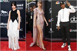 (From left) Camila Cabello, Taylor Swift and Rapper T.I. attend the 2018 Billboard Music Awards, on May 20, 2018.