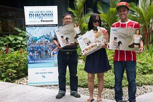 ST Run Mother's Day Giveaway winners (from left) Mr Yeo Buck Huat, Ms Lee Poh Lin and Mr Irfan Noor.