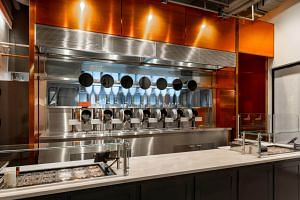 Boston restaurant Spyce relies on seven autonomous cooking pots and other technology to prepare customer's meals.