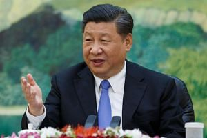 China's President Xi Jinping attending a meeting at the Great Hall of the People in Beijing on May 15, 2018.