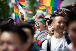 People attending the annual Tokyo Rainbow Parade on May 6, 2018, to show support for members of the LGBT community.