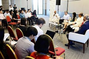 Minister for the Environment and Water Resources Masagos Zulkifli (fourth left on panel), during his first Facebook Live panel discussion yesterday, which was broadcast worldwide. Among other topics, he drew attention to the importance of separating