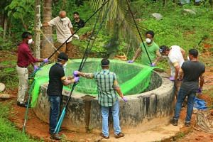 Animal Husbandry department and Forest officials inspect a well to to catch bats at Changaroth in Kozhikode, on May 21, 2018. At least nine other people have died in the Nipah outbreak in Kozhikode.
