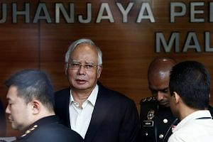 Malaysia's embattled former prime minister Najib Razak arrives at the Malaysian Anti-Corruption Commission at 9.45am, in time for his 10am appointment, on May 24, 2018.