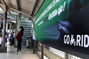 A Go-Jek ad at a railway station in Jakarta. The Indonesian ride-hailing firm said it would spread its services to the Philippines, Singapore, Thailand and Vietnam in the next few months, without specifying any dates.
