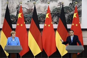 Chinese Premier Li Keqiang speaks during a joint press conference with German Chancellor Angela Merkel after their bilateral meeting at the Great Hall of the People in Beijing yesterday.
