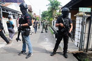 Anti-terror police conduct a raid in Tangerang, Indonesia, on May 16, 2018.