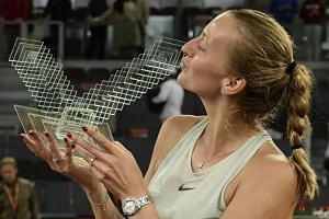 Kvitova kissing her trophy after winning the Madrid Open in May 2018.