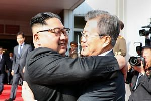 South Korean President Moon Jae In and North Korean leader Kim Jong Un hold their second summit at Tongilgak, on North Korea's side of the truce village of Panmunjom, on May 26, 2018.