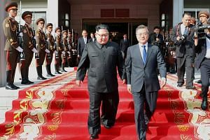 South Korean President Moon Jae In (right) and North Korean leader Kim Jong Un leave after their summit at the truce village of Panmunjom, North Korea, on May 26, 2018.
