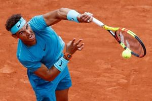 Rafael Nadal had been two sets up but 0-3 down in the third when rain caused the tie to be suspended.