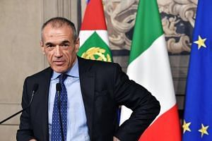 Carlo Cottarelli addresses a press conference at the Qurinale presidential palace in Rome after the Italian President gave him the mandate to form a government on May 28, 2018.