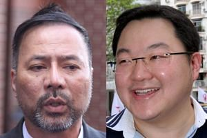 "Former Umno politican Khairuddin Abu Hassan (left) said that he has talked extensively with Interpol agents to place Jho Low its ""red alert"" watch."