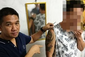 The suspect, who is in his 40s and has a large tattoo on his right arm, was apprehended by a team of Thai police officers in Chaiyaphum province, Thailand.