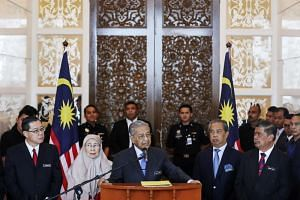 Malaysian Prime Minister Mahathir Mohamad (centre) said the fund was necessary to ensure that the donations from patriotic Malaysians would reach the Ministry of Finance.