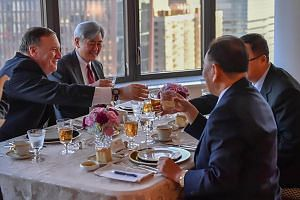 North Korean envoy Kim Yong Chol (right), during his dinner meeting with US Secretary of State Mike Pompeo (left) in New York, on May 30, 2018.