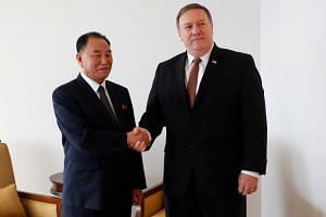 North Korean envoy Kim Yong Chol (left) shakes hands with US Secretary of State Mike Pompeo during their meeting in New York, on May 31, 2018.