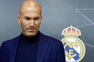 Real Madrid's French coach Zinedine Zidane looks on after a press conference to announce his resignation in Madrid on May 31, 2018.
