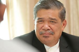 Malaysian Defence Minister Mohamad Sabu was sworn in as a Cabinet minister on May 21 after the Pakatan Harapan alliance was voted into power in Malaysia's general election last month.
