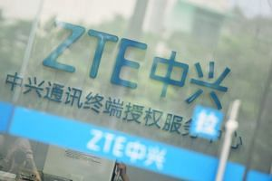 ZTE Corp was banned from buying US technology components for seven years for breaking an agreement reached after it was caught illegally shipping goods to Iran and North Korea.