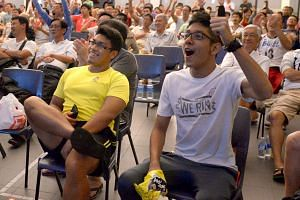 The audience at the Bedok Community Centre reacting to England's equaliser at the 3am live screening of their World Cup 2014 defeat by Uruguay.