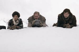 Cinema still of Solo: A Star Wars Story starring (from left) Thandie Newton, Woody Harrelson and Alden Ehrenreich. The film clung to the top spot in North American theatres this weekend but again fell below expectations.
