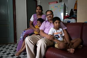 Security guard Yeo Phong Chew, 59, and his wife Lum Sok Yeng, 48, in their three-room Circuit Road flat. They do not want to move even if offered attractive rehousing terms. Technician Aruljothi Arimuthu, 45, his wife Sumathi Rajagopal, 40, and their