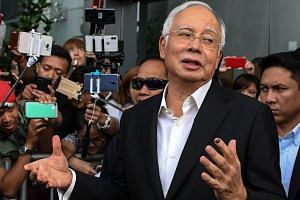 Malaysia's former premier Najib Razak has been barred from leaving the country since his surprise defeat in last month's election.