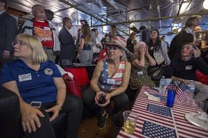 Supporters watching election returns at the Republican Representative Dana Rohrabacher, 48th District, election night party at his campaign headquarters on June 5, 2018 in Costa Mesa, California.