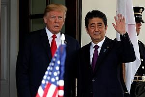 US President Donald Trump welcoming Japanese Prime Minister Shinzo Abe at the White House yesterday.