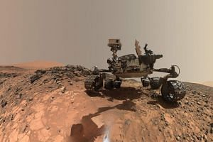 """A Nasa photo shows the Curiosity rover at the site from which it reached down to drill into a rock target called """"Buckskin"""" on lower Mount Sharp."""