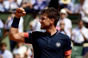 Thiem reacts after beating Marco Cecchinato of Italy during their men's semi-final match.