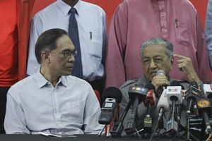 Malaysian Prime Minister Mahathir Mohamad (right) will hand over to Datuk Seri Anwar Ibrahim (left) after his stint at the premiership.
