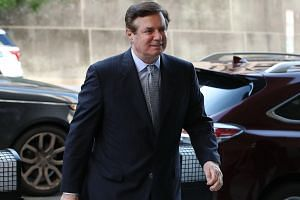 Former Trump campaign manager Paul Manafort and his associate were accused of attempting to sway the testimony of two potential witnesses who might offer evidence against him.